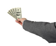 500 Dollars in 100 Dollar Bills. A businessman holds his bonus pay isolated on white Royalty Free Stock Photos