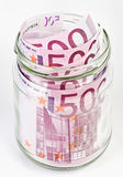 500 Euro bank notes in a glass jar Stock Images