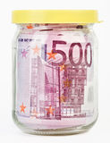 500 Euro bank notes in a glass jar Stock Image