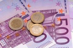 500 euro e monete Fotografia Stock