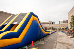 500-foot Waterslide Downhill. Grand Rapids, MI Aug 21: Lyon Street in Grand Rapids, is transformed into a waterpark for Aug 21 & 22, 2010 with a 500-foot Royalty Free Stock Image