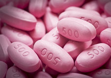 500 Milligrams. Pink 500 milligrams pills in a grouping Royalty Free Stock Image