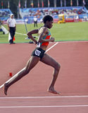 5000 metres women kenya barefoot. MONCTON, CANADA - JULY 21: Eventual bronze medalist Alice Aprot Nawowuna of Kenya runs the 5000 metres final in her bare feet Royalty Free Stock Images