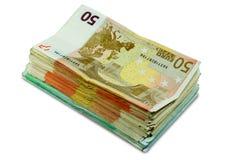 欧洲金钱钞票-被堆积的50张和100张欧洲票据 库存照片