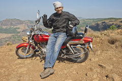 5053 Biker on an Indian Hilltop waving to camera Stock Images