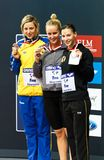 50m medalists. Pose for a group shot on the podium. Gold medalist: Jessica Hardy, silver: J. Johansson, bronze Dorothea Brandt. 2010 Fina Swimming World Cup royalty free stock photography