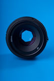 50mm lens face. 50mm lens isolated on blue background Stock Image