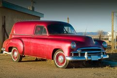 50s Red Hotrod Panel Car. An early red 50s Panel Wagon hotrod poses in the late afternoon sunlight stock image
