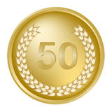 50th anniversary laurel wreath. On a gold medallion Stock Image
