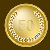 50th anniversary laurel wreath. On a gold medallion Stock Images