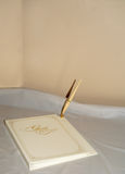 50th Wedding Anniversary Guest Book. White 50th Wedding Anniversary Guest Book With Gold Lettering stock image
