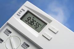 55 grader värmer upp skytermostaten v2 Arkivfoto