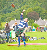 56 pound weight over the bar. An image of a competitor attempting to put a 56 pound weight over the bar  at the Glenurquhart Highland Gathering and Games on Royalty Free Stock Image