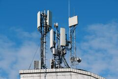 Free 5G Cell Towers On Sky Background Stock Photography - 211596352
