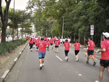 5K Street Race. Runners in a 5K race in a cloudy morning in Sao Paulo, Brazil, for the fight against Breast Cancer Royalty Free Stock Image