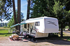 5th Wheel RV Camping. RV park camping in a fifth wheel royalty free stock photo