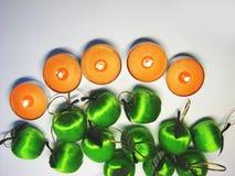 6 äpplestearinljus Arkivfoton