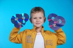 6 chłopiec cd chwytów zdjęcie royalty free