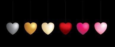 6 coeurs sur des chaînes de caractères Photo stock