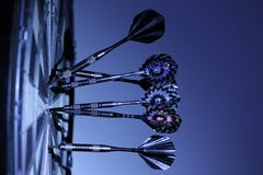 6 Dart Pins on Dart Board Stock Photos