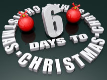 6 Days to Christmas. The words 6 Days to Christmas on a shiny green background with two red ornaments Stock Photos