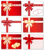 6 Gift Boxes with Hearts. Mix and match. 6 gift boxes with white, gold & red hearts, bows, ribbons, entwined hearts gift cards with copy space: 3 ribbon styles Stock Photo
