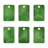 6 Green tags with flowers. Isolated on white Stock Photography