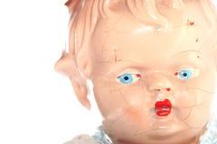 6 missbrukad gammal barndocka Arkivfoto