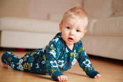 6 mobth old baby crawling on floor at home Royalty Free Stock Images