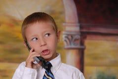 6 pojketelefonbarn Arkivfoto