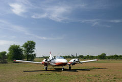 6-seats plane in tanzania. A 6-seats plane parking in serengeti park in tanzania Royalty Free Stock Images