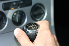 6 speed stick shift. Man changing gears Stock Photography