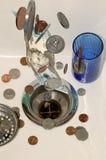 6 tömmer ner pengar Arkivbild