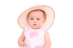 6 van het babymaanden meisje in hoed Stock Foto's