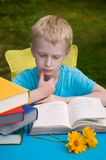 6-year boy reading book Stock Image
