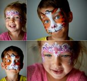 6 Years Old Boy With Blue Eyes Face Painting Of A Cat Or Tiger. Pretty Exciting Blue-eyed Girl Of 2 Years With A Face Stock Photography