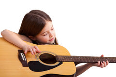 6 years old girl plays on the guitar Stock Image