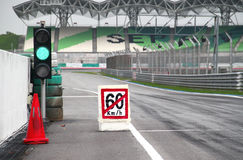 60km/h pit stop exit. Pit stop exit into main track with speed limit 60km/h Stock Photos