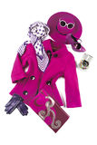 60s fashion still life. Composition in pink and purple tones comprising picture hat, sunglasses, jacket, neckerchief, bracelets, high heels, purse and gloves Stock Photos