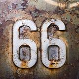66 unità di struttura ed il numero di ruggine Fotografie Stock Libere da Diritti