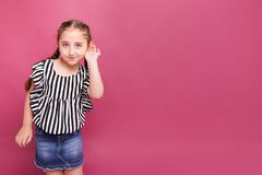 Free 7-8 Years Old Girl Hold Her Hand Near Her Ear With Listening Something On Pink Background Royalty Free Stock Photography - 189513517