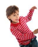 7 años el jugar del muchacho Fotografía de archivo libre de regalías