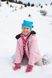 7 Einjahresmädchen auf Winter-Ferien Stockfoto