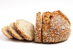 7-grain bread cut in slices. Loaf of wholemeal bread with first half already cut into slices Stock Photos