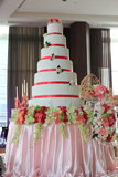 7-layer white wedding cake in party Stock Photography