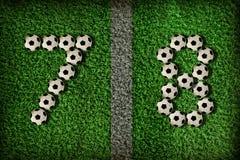 7 nummer för 8 fotboll Arkivfoto