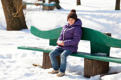 7 year old girl on a bench Royalty Free Stock Photography