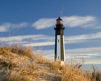 70 Lighthouse. New Cape Henry lighthouse and sand dune stock photo