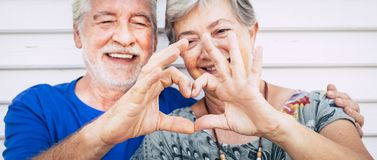 70 Year Old Senior Couple Playing Forming Heart With Hands. Happiness And Joy Together Forever Concept For Old People Man And Royalty Free Stock Photo