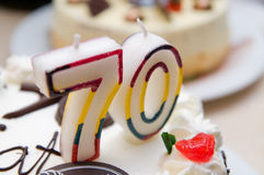 70 years old candles. On a cream cake Royalty Free Stock Images
